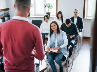 red-shirt-group-people-business-conference-modern-classroom-daytime